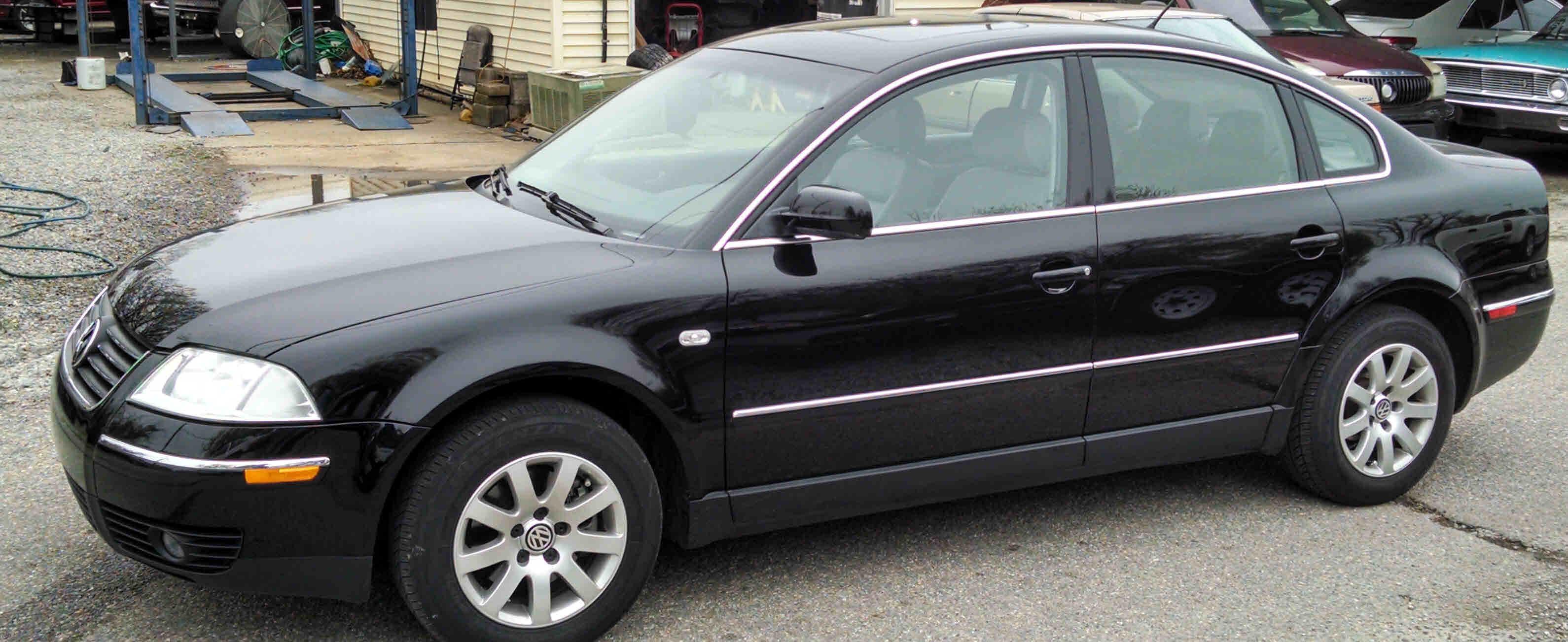 2003 vw passat 1 8t black light grey leather interior 4 cylinder 1 8 turbo auto one owner 4 door power sunroof a c cruise tilt am fm