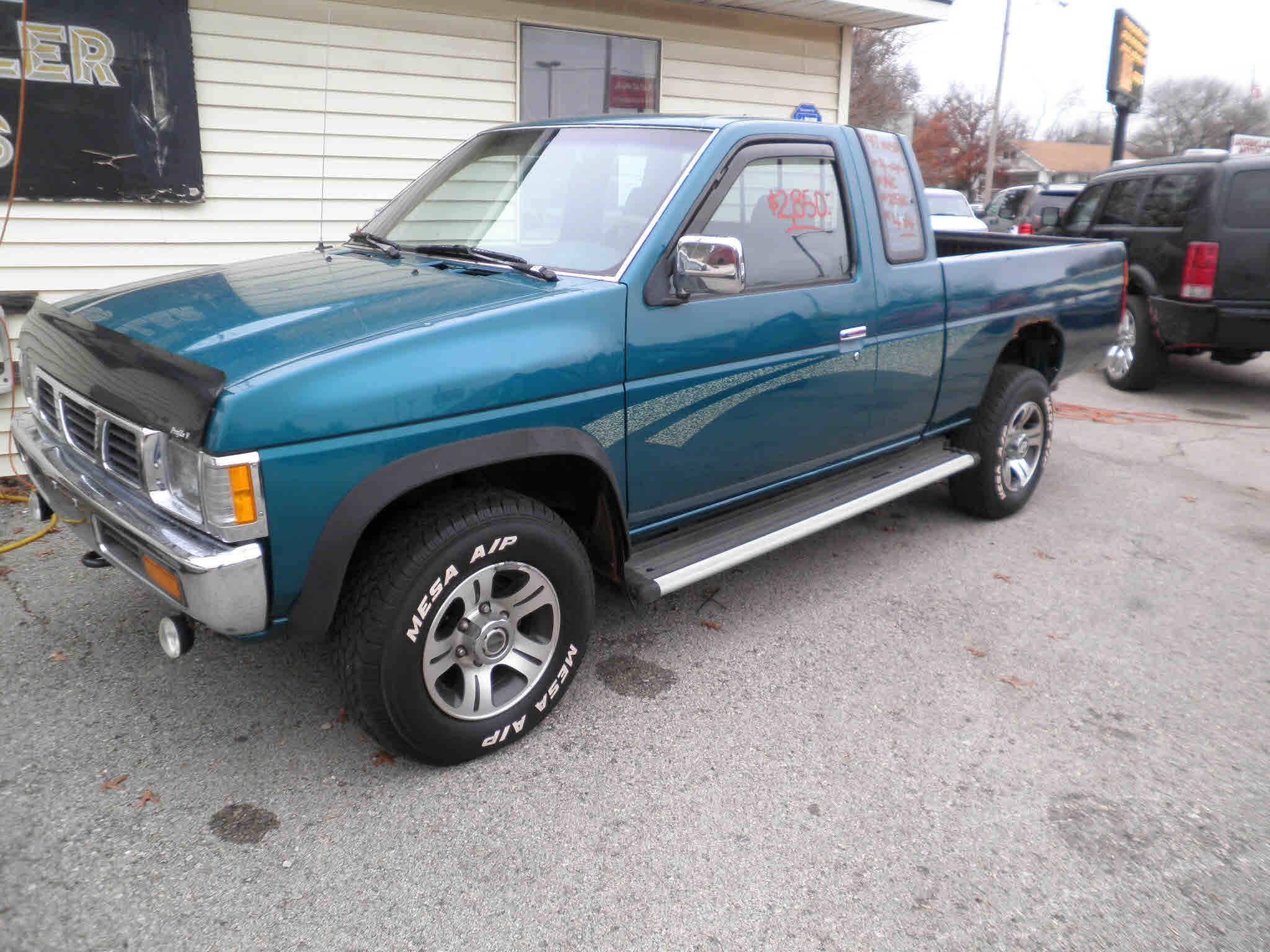 1997 nissan pickup green grey cloth interior 4 cylinder 5 speed 4x4 2 door a c tilt am fm 233 425 miles local truck great farm truck
